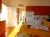 22-kitchen-looking-north-to-sitting-room_